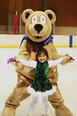 Image of child skater with Snow Plow Sam the skating bear bear
