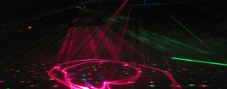 Image of laser lights on the ice during laser light session