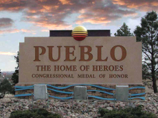 Pueblo Home of Hero Sign.png