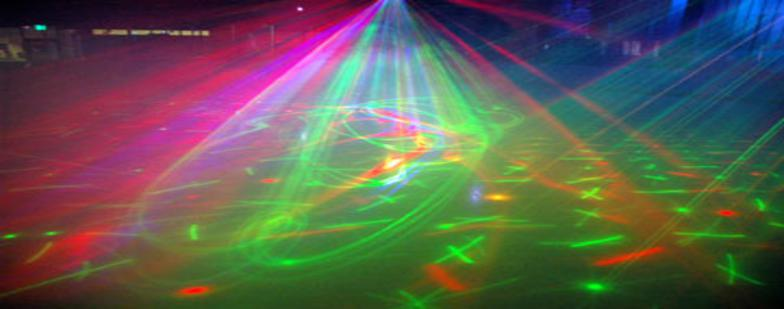 Image of lazers shining down on the ice