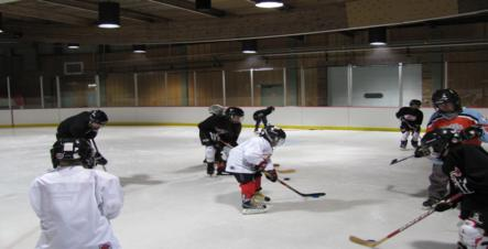 Image of youth learnning to play hockey