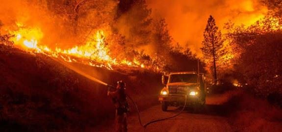 image of firefighters fighting a wildfire