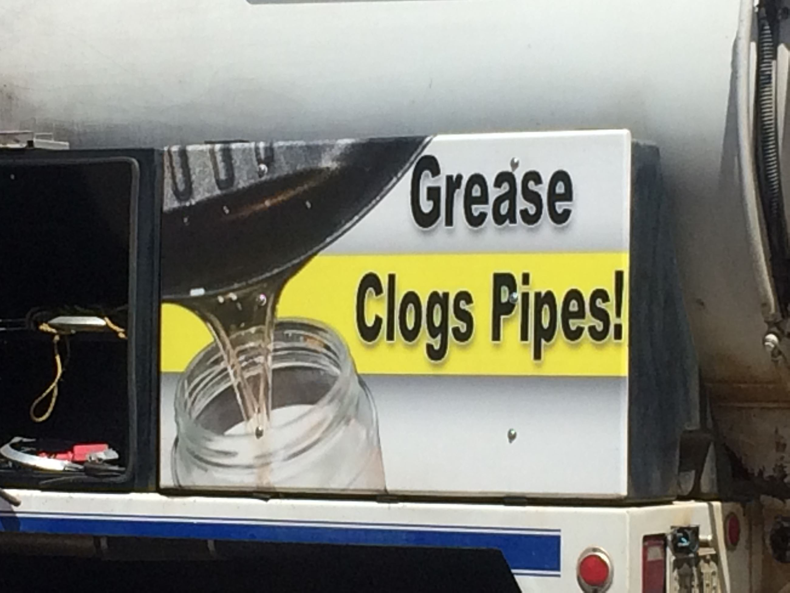 Grease Clogs Pipes! Put it in the Trash!