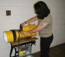 Woman working on pretreatment machine